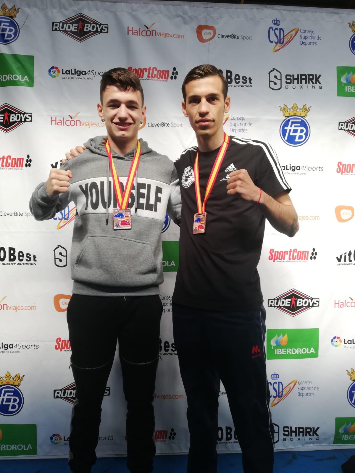 Álex Muñoz y Jordi Martínez con sus medallas